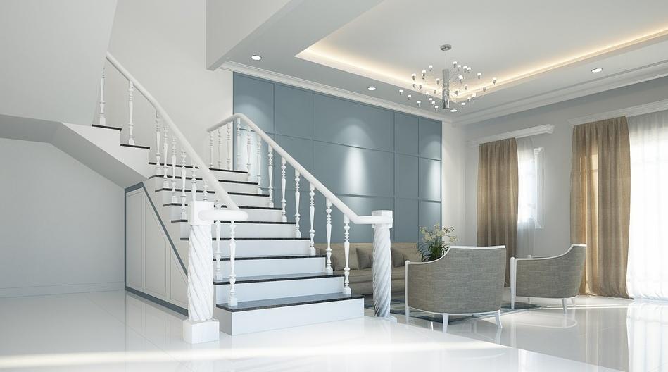 Białe schody z drewna w domu